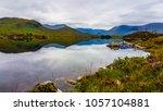scottish lake reflection  | Shutterstock . vector #1057104881