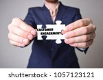 businessman holding a puzzle...   Shutterstock . vector #1057123121