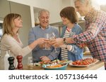 senior people cheering with... | Shutterstock . vector #1057136444