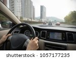 driving car on city street with ... | Shutterstock . vector #1057177235
