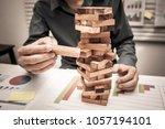 hands of business man playing a ...   Shutterstock . vector #1057194101