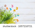 easter cookies on white wood... | Shutterstock . vector #1057210721