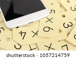 smartphone and arithmetic | Shutterstock . vector #1057214759
