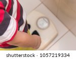 the child stands on the floor... | Shutterstock . vector #1057219334