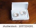 wedding rings in white gift box ... | Shutterstock . vector #1057224281