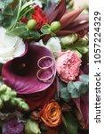 two wedding rings in flower... | Shutterstock . vector #1057224329