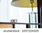 wedding rings on mirror frame... | Shutterstock . vector #1057224335