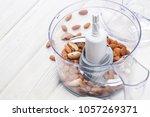 almonds in a food processor...   Shutterstock . vector #1057269371
