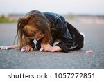 little happy girl draws... | Shutterstock . vector #1057272851