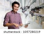 young asian businessman using...   Shutterstock . vector #1057280219