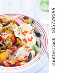 Fresh vegetable salad with tomatoes, onion, micro greens and mozzarella cheese - stock photo