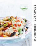 Salad with tomatoes and mozzarella with fresh basil, capers and onion - stock photo