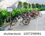 Small photo of Marina Barrage , Singapore - September 3 2017: A lot of bicycle park at bicycle parking area of marina barrage singapore