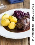 Small photo of Beef roulade with potatoes and red cabbage