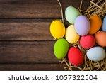 easter eggs in the nest on... | Shutterstock . vector #1057322504
