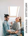 young couple having fun in... | Shutterstock . vector #1057331684