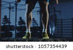 crop view of athlete jumping on ... | Shutterstock . vector #1057354439