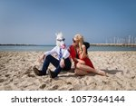 young man in suit sits with... | Shutterstock . vector #1057364144