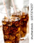 glass of soda with ice cubes | Shutterstock . vector #1057374257
