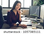 boss woman is working with... | Shutterstock . vector #1057385111