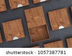 empty dark wooden square box... | Shutterstock . vector #1057387781