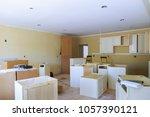 custom kitchen cabinets in... | Shutterstock . vector #1057390121