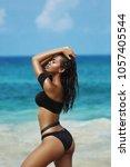 beautiful sexy woman in bikini... | Shutterstock . vector #1057405544