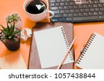 paper and notebooks are placed... | Shutterstock . vector #1057438844