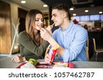 caucasian couple eating french... | Shutterstock . vector #1057462787