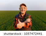 portrait of senior farmer with... | Shutterstock . vector #1057472441