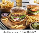 hamburgers and french fries on...   Shutterstock . vector #1057482479
