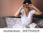 woman with sleeping mask awake | Shutterstock . vector #1057510229