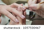 cover gel with nail polish.... | Shutterstock . vector #1057530467