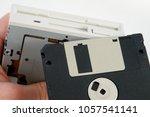 hand holding 3 1 2 inch fdd... | Shutterstock . vector #1057541141