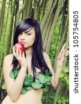 beautiful woman with an apple in the image of Eve - stock photo