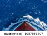 Small photo of Ship's bow, moving through the waves to her destination. View from forecastle deck.