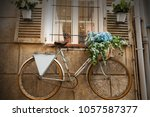 bicycle on facade with window... | Shutterstock . vector #1057587377