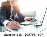 finance manager working with... | Shutterstock . vector #1057594109