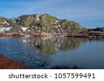 A Pond Sits In Front Of A...