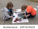 two boys are working on a... | Shutterstock . vector #1057615625