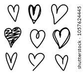 set of nine hand drawn heart.... | Shutterstock .eps vector #1057624445