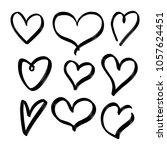 set of nine hand drawn heart.... | Shutterstock .eps vector #1057624451