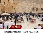 JERUSALEM, ISRAEL - APRIL 12: View on the Wailing Wall, orthodox religious Jews and tourists during the Jewish Pesach (Passover) celebration on April 12, 2012 in Jerusalem, Israel - stock photo