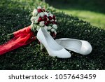 wedding shoes and a bouquet on...   Shutterstock . vector #1057643459