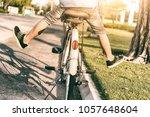 boy's leg cycling in the park... | Shutterstock . vector #1057648604