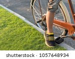 boy's leg cycling in the park... | Shutterstock . vector #1057648934