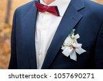 white boutonniere groom closeup.... | Shutterstock . vector #1057690271