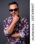 studio shot of young bearded... | Shutterstock . vector #1057698497