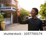 portrait of young handsome...   Shutterstock . vector #1057700174