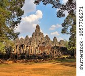 the bayon temple in angkor ... | Shutterstock . vector #1057708271